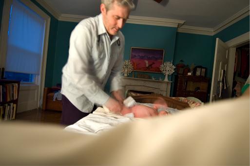 A Woman Changing Man's Diaper